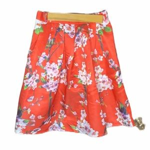 Red floral small skirt. Partially lined.side zip